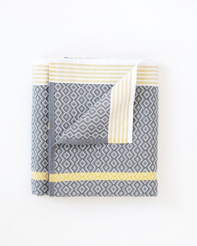 Mungo Itawuli Bath sheets and beach towels in Cango Grey with a mustard stripe detail