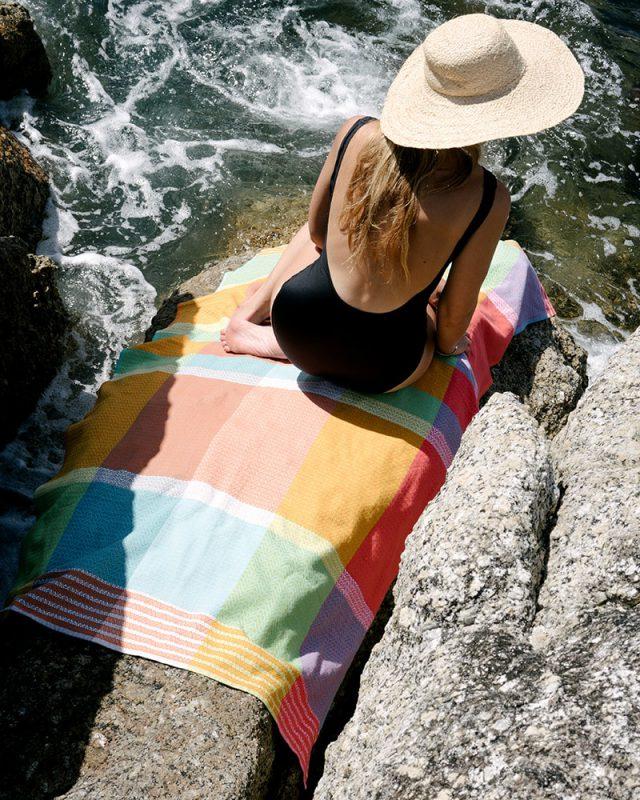 Mungo Folly Beach towel in Fiddler Crab at Bakoven beach in Cape Town