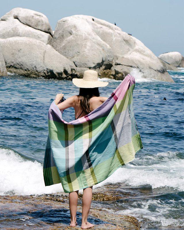 Mungo Folly Beach towel in Blue Crab at Bakoven beach in Cape Town